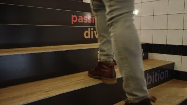 vídeos de stock e filmes b-roll de male professional moving up on steps with text - nova empresa