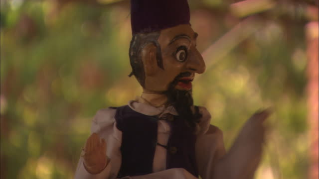 Male puppet talks and gestures to audience Rajasthan India Available in HD.