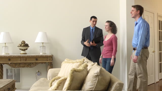 Male Real Estate Agent Showing Home