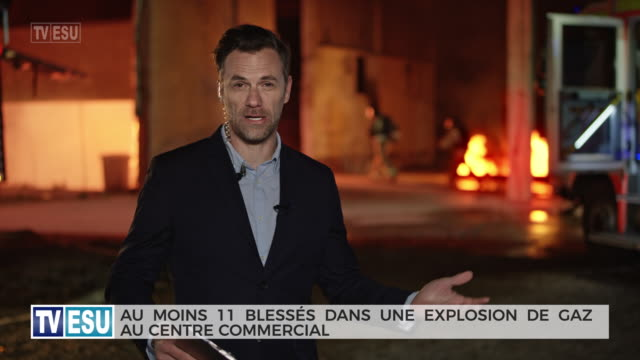 male reporter reporting from the scene of a gas explosion accident - french language stock videos & royalty-free footage