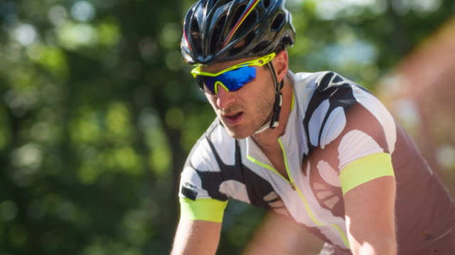 male road cyclist during sports training - racing bicycle stock videos and b-roll footage