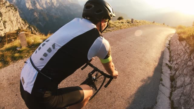 male road cyclist speeding downhill - wearable camera stock videos & royalty-free footage