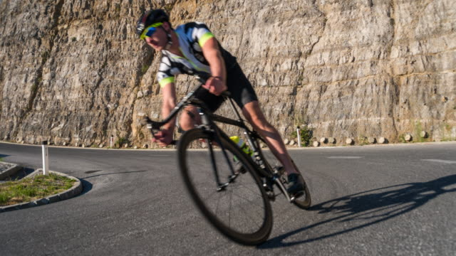 male road cyclist speeding downhill - triathlon stock videos & royalty-free footage