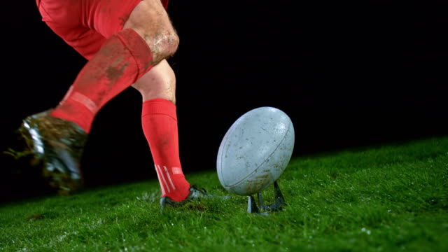 slo mo male rugby player in red outfit kicking the ball - kicking stock videos & royalty-free footage