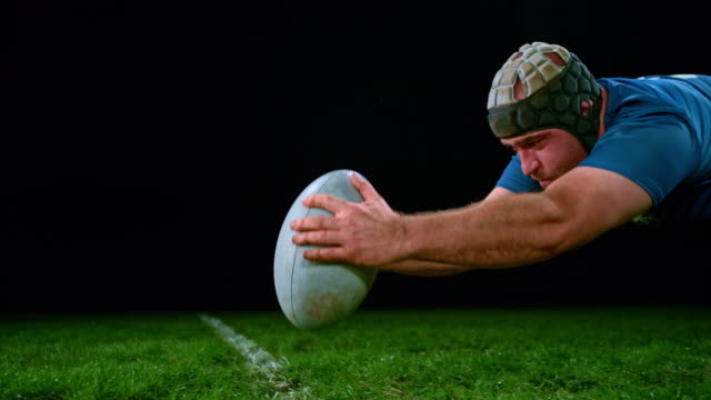slo mo male rugby player scoring a point - rugby stock videos & royalty-free footage