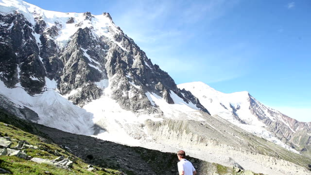 Male runner heads up the mountain slopes by Mont Blanc