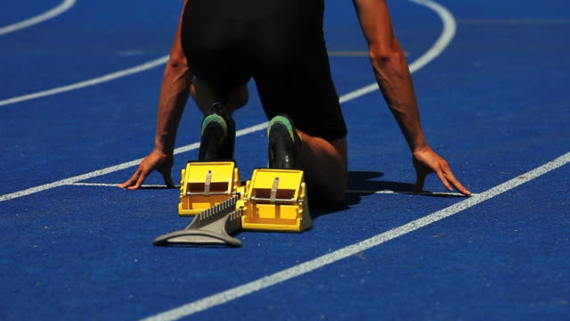 HD Male Runner Sprinting Off Starting Block