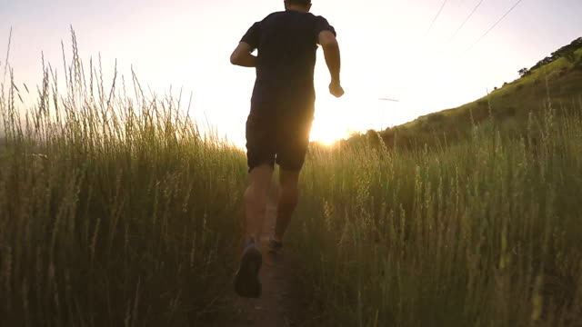 male running on utah mountain trail - 40 44 years stock videos & royalty-free footage