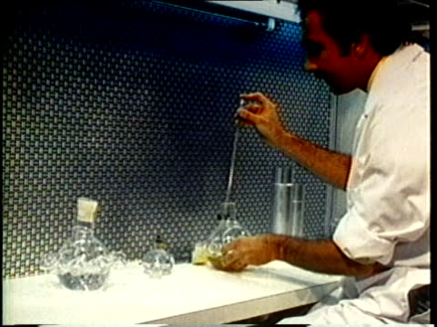 vidéos et rushes de 1980 ms male scientist at work in laboratory / united states / audio - blouse de laborantin