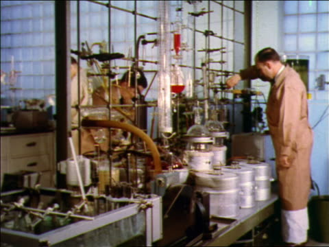 1957 2 male scientists working in laboratory - 1957 stock-videos und b-roll-filmmaterial