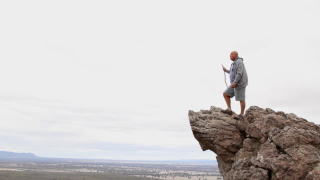 male senior at the top of a mountain