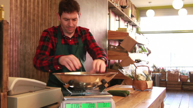 male shop assistant weighting vegetables - scales stock videos & royalty-free footage