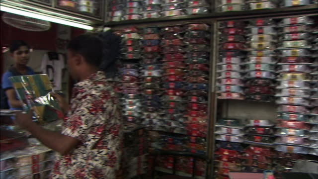 A male shopper looking at shirts