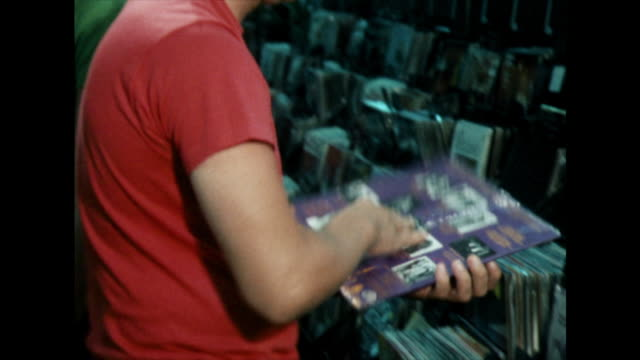 male shoppers examine vinyl records in shop;1981 - 1981 stock videos & royalty-free footage