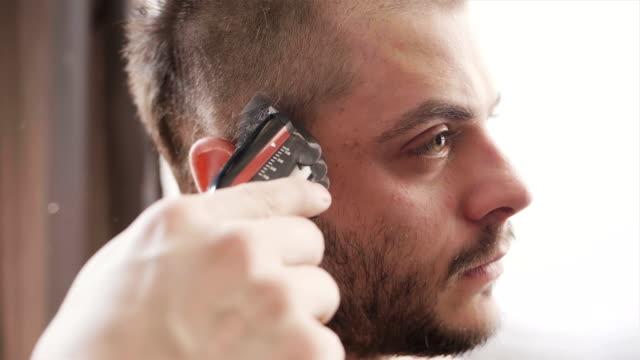 male short hair cut by hair cutting machine - cutting hair stock videos and b-roll footage