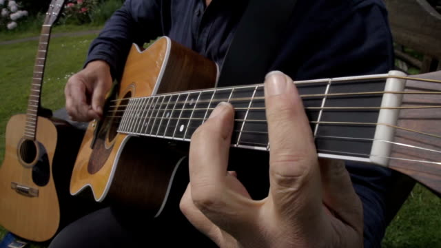 male singer songwriter in slow motion - folk music stock videos and b-roll footage
