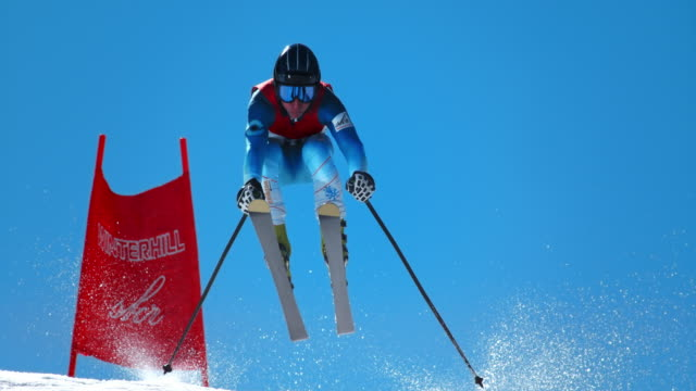 SLO MO Male skier airborne at giant slalom race