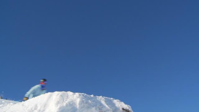 LA male skier back flip off jump / Blaine County, Idaho, United States
