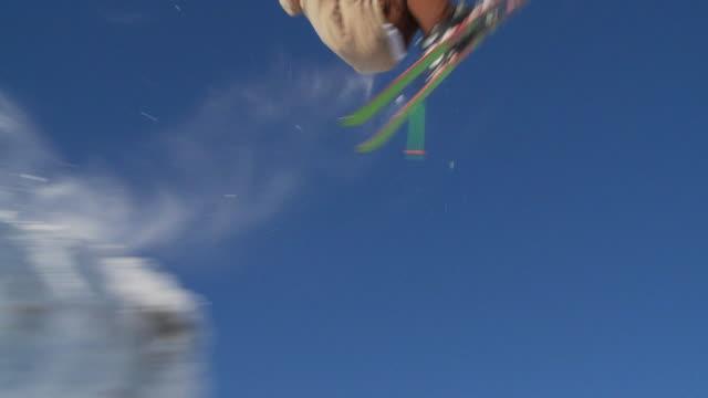 la slo mo male skier back flips off jump / blaine county, idaho, united states - freestyleskidåkning bildbanksvideor och videomaterial från bakom kulisserna