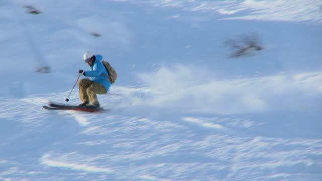 Male skier carving through steep terrain / Blaine County, Idaho, United States