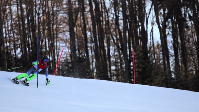 slo mo male skier competing at a slalom race - slalom skiing stock videos & royalty-free footage