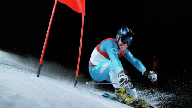 slo mo male skier competing at night giant slalom race - ski goggles stock videos & royalty-free footage