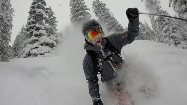 POV of male skier descending powder snow slope