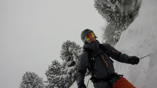 pov of male skier descending powder snow slope - ski jacket stock videos & royalty-free footage