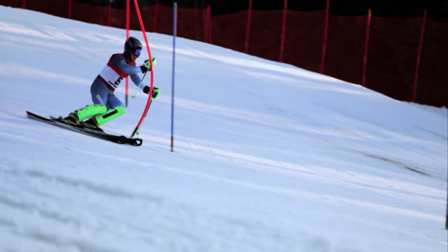 SLO MO Male skier passing the gates at slalom competition
