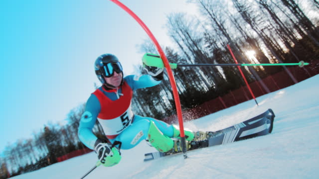 SLO MO Male skier passing the poles at a slalom race