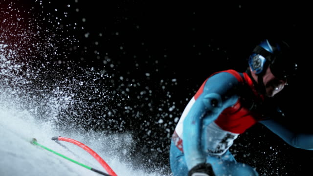 slo mo male skiing competitor passing a pole at a night slalom race - ski pole stock videos & royalty-free footage
