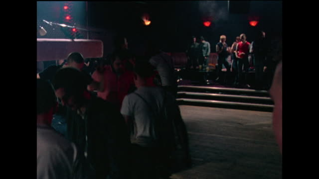 male skinheads dance aggressively in nightclub; 1982 - nightclub stock videos & royalty-free footage