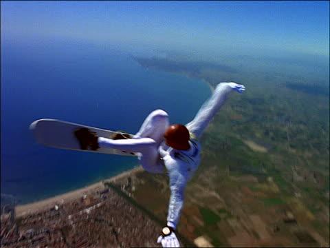 male skysurfer over farm fields + coastline - parachuting bildbanksvideor och videomaterial från bakom kulisserna
