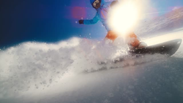 speed ramp male snowboarder riding through powder and splashing the camera lens - winter sport stock videos & royalty-free footage