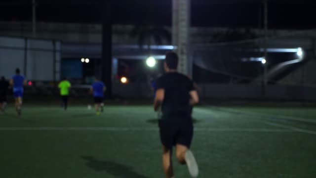 ms male soccer player running with teammates on field before evening soccer match - soccer sport stock videos & royalty-free footage