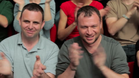 male spectators clapping, camera moves from right to left - encouragement stock videos & royalty-free footage