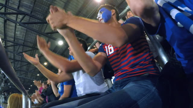 ld male sports fan with a painted face sitting on the tribune and clapping his hands - face paint stock videos & royalty-free footage