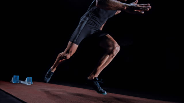 slo mo ds male sprinter starting from a starting block - vest stock videos & royalty-free footage