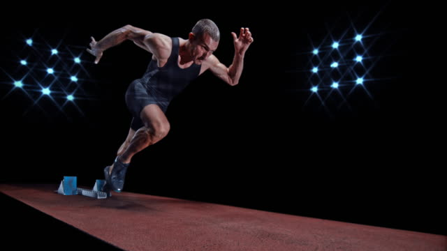 slo mo ds male sprinter taking off from the starting block - track and field event stock videos and b-roll footage