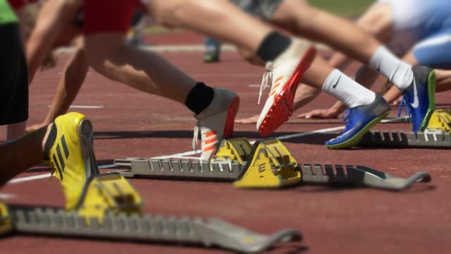 Male Sprinters Preparing For Start