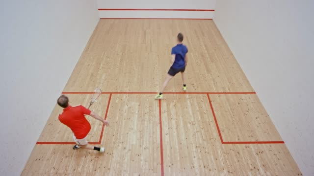 male squash coach and his male student playing squash - squash sport stock videos & royalty-free footage