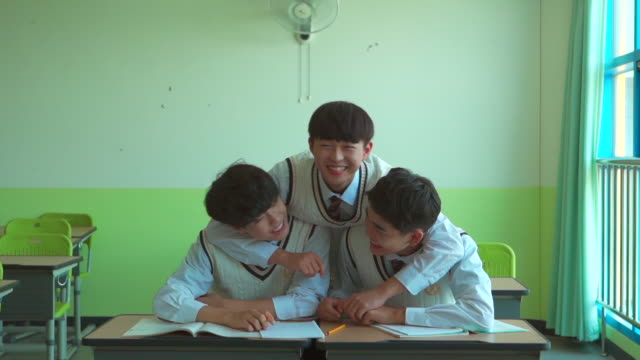A male student group playing in the classroom