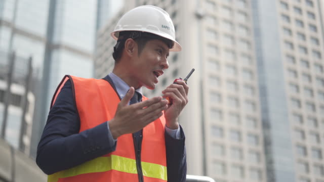 male supervisor talking, using walkie-talkie in factory, using walkie-talkie in  construction site - leaning stock videos & royalty-free footage