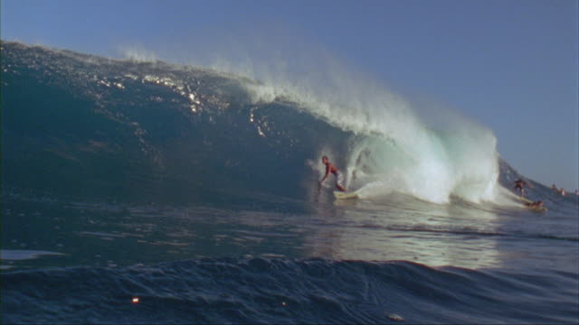 slo mo, ws, male surfer in ocean waves, oahu's north shore, hawaii, usa - approaching stock videos & royalty-free footage