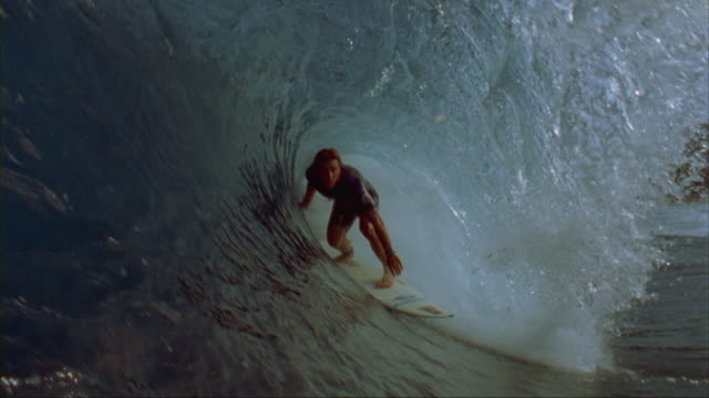 SLO MO, WS, CU, Male surfer in ocean waves, Oahu's North Shore, Hawaii, USA