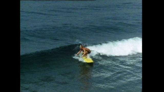 male surfer riding a wave at hermosa beach; 1972 - semi dress stock videos & royalty-free footage