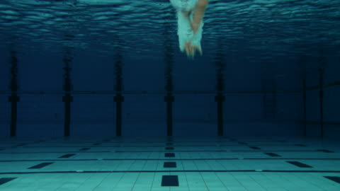 male swimmer jumping into pool - diving into water stock videos & royalty-free footage
