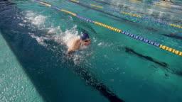 Male Swimmer Swimming Butterfly Stroke In Slow-Motion