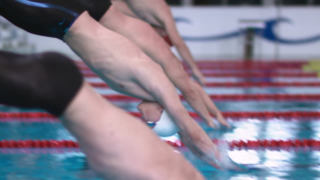 slo mo ds male swimmers' start at a competition - the olympic games stock videos & royalty-free footage