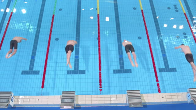 AERIAL Male swimmers' start at breaststroke competition
